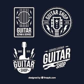 Conjunto de quatro logotipos de guitarra em design plano