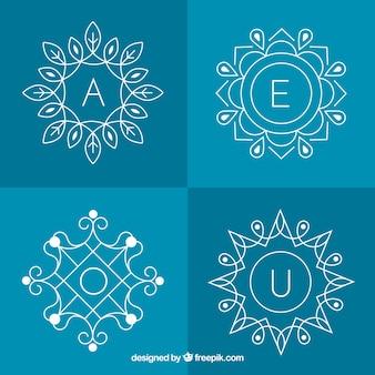Conjunto de quatro monogramas florais