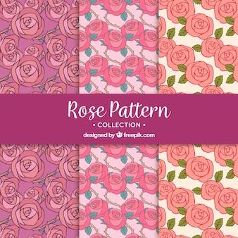 Conjunto de três padrões decorativos com rosas rosa