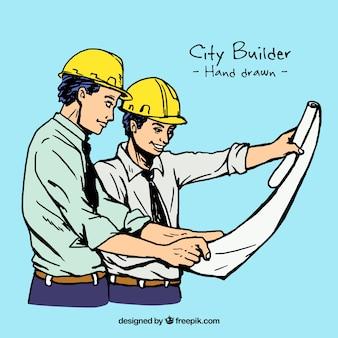 construtores desenhados mão olham o plano