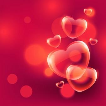Corações bonitos do amor bolhas que flutuam no ar no fundo vermelho do bokeh