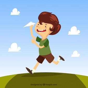 Criança que joga com uma ilustração do avião de papel