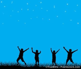 Crianças brincando no céu estrelado