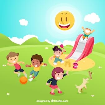 Crianças que jogam no campo de jogos