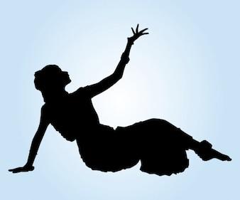 Dançarino indiano na silhueta Pavimento
