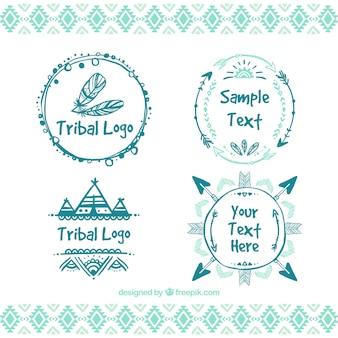 Desenhadas mão logos tribais