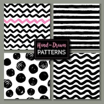 Desenho conjunto de padrões preto e branco sem costura