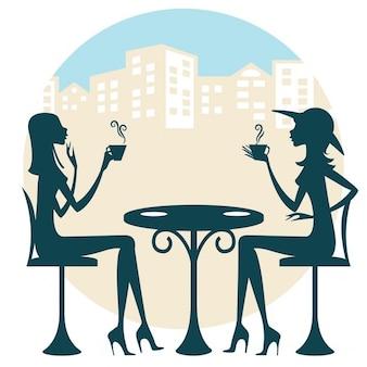 Dois amigos que têm uma bebida e que falam