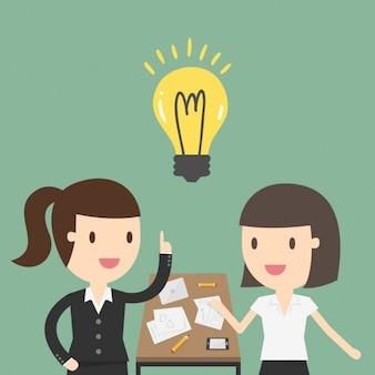 Duas mulheres de negócio que trabalham no escritório