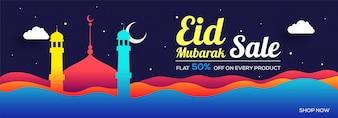 Eid Mubarak Sale banner decorado com mesquitas coloridas e ondas abstratas.