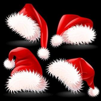Elegantes chapéus de Papai Noel vector