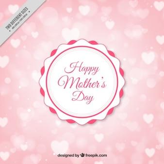 emblema do vintage do dia de mãe em um fundo dos corações