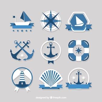 Emblemas azuis e brancas com artigos náuticos