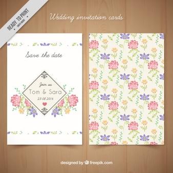 Entregue o cartão de casamento flores desenhadas