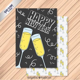 Entregue o cartão de champanhe ano novo desenhada