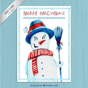 Entregue o cartão de Natal do boneco de neve pintado