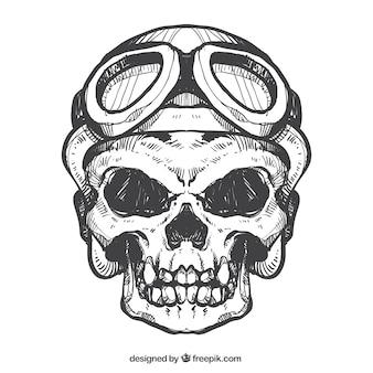 Esboço do crânio com capacete e óculos