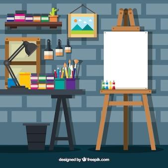 Estúdio bonito da arte com uma parede de tijolos