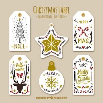 Etiquetas do Natal bonitas com detalhes dourados