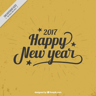 Feliz ano novo, letras pretas sobre um fundo dourado