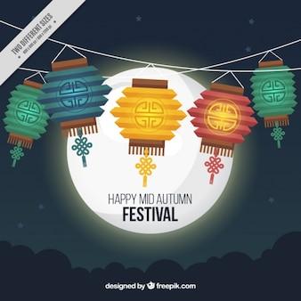 Feliz festival meados de outono com lanternas e Lua