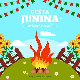 Festa junina fundo com fogo em uma paisagem