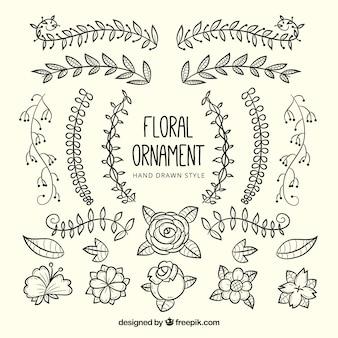 Flores decorativas desenhadas a mão e folhas