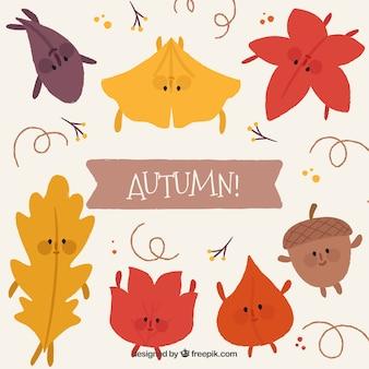 Folhas de outono sorridentes com design plano
