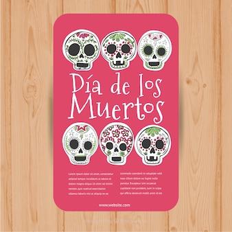 Folheto de-rosa com seis caveiras mexicanas decorativos