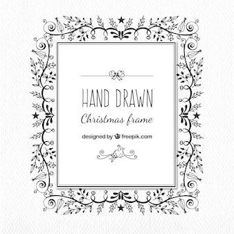 Frame do Natal desenhados à mão ornamentos florais
