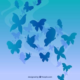 Fundo azul com silhuetas da borboleta em tons azuis