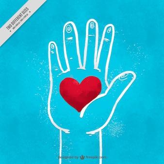 Fundo azul esboço da mão com um coração vermelho