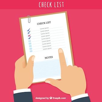 Fundo com mão que aponta uma lista de verificação