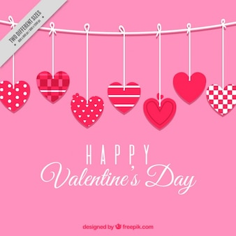Fundo cor de rosa dos corações com desenhos diferentes para o Dia dos Namorados