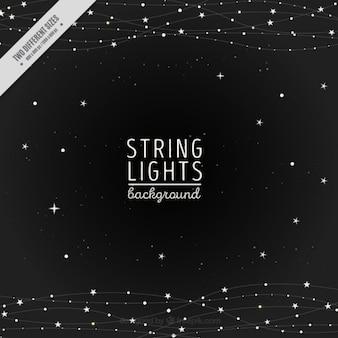 Fundo da noite de luzes da corda e estrelas