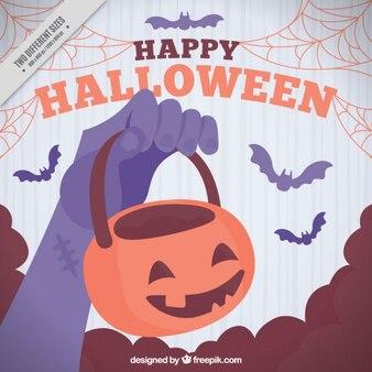 Fundo de Halloween bonito com a mão que prende uma abóbora