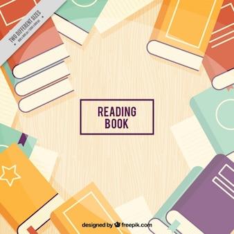Fundo de madeira com livros coloridos planas