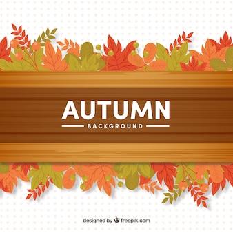Fundo de outono com madeira e folhas