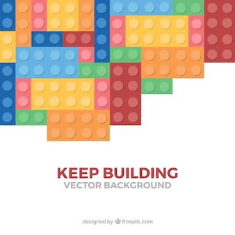 """Fundo de peças com mensagem """"continuar construindo"""""""