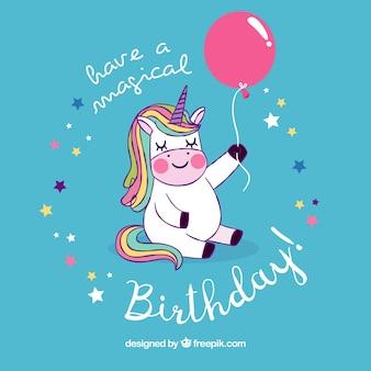 Fundo de unicórnio adorável com balão de aniversário