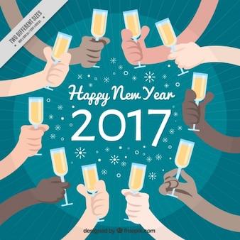 Fundo do ano novo das mãos com vidros do champanhe