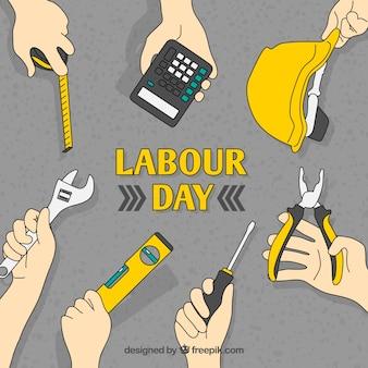 Fundo do dia de trabalho de mãos com ferramentas
