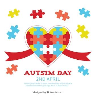 Fundo do dia do autismo com coração e peças do puzzle