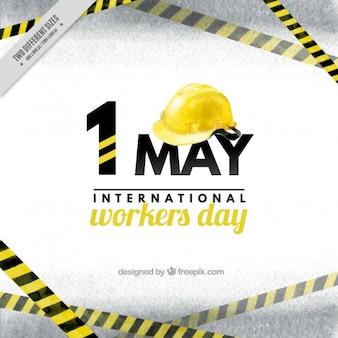 Fundo do dia os trabalhadores com um capacete amarelo