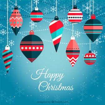 Fundo do Natal com esferas e flocos de neve