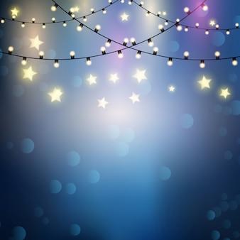 Fundo do Natal com luzes penduradas cordas