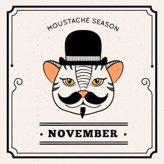 Gato com bigode e chapéu para comemorar movember