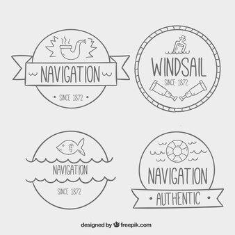 Grandes emblemas náuticas com elementos desenhados à mão