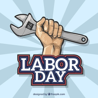 Hand retro background with wrench for working day