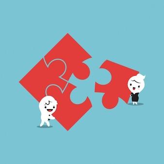 Homem e mulher de montar peças de quebra-cabeça